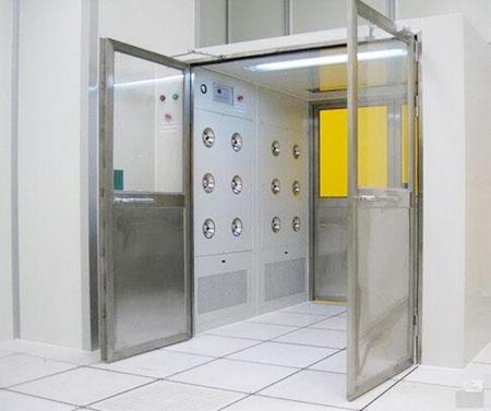 Manually operated door cargo shower